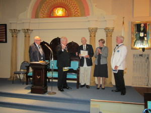 Brother Bartlett receiving the Certificate